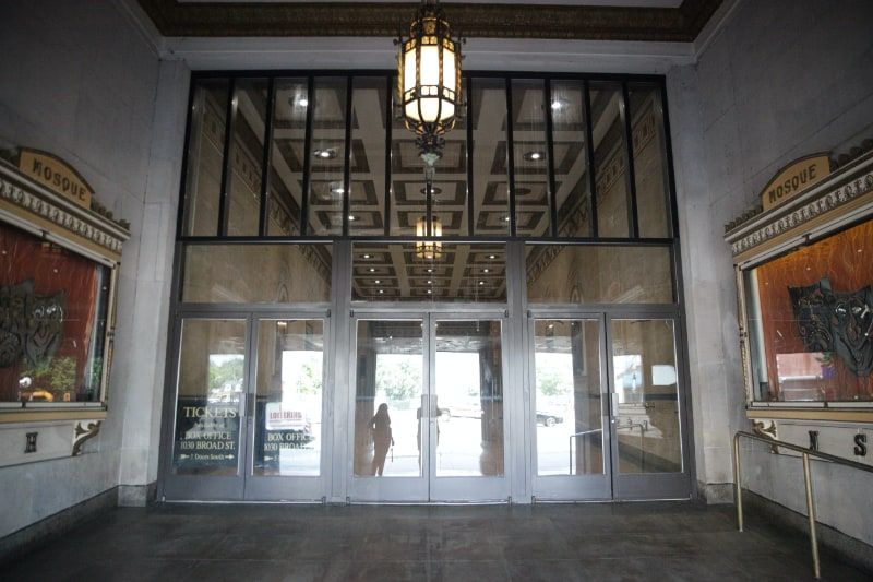 newark symphony hall front doors with large pendant light