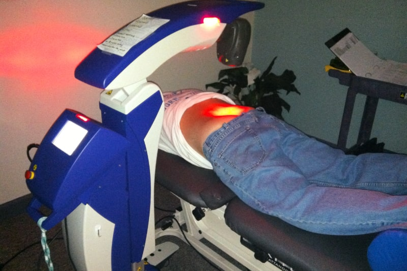 MLS laser treating a patients back pain.