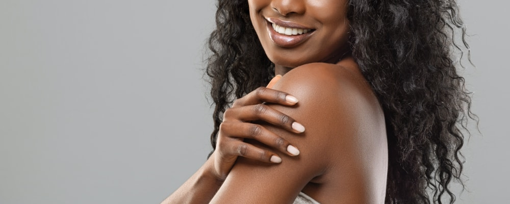 Woman with smoothed, toned, and tightened beautiful face and body.