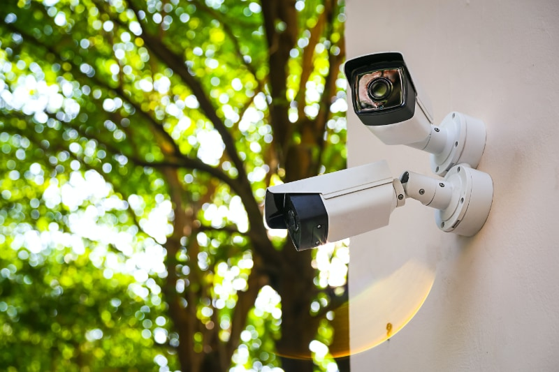 two security cameras attached to side of building