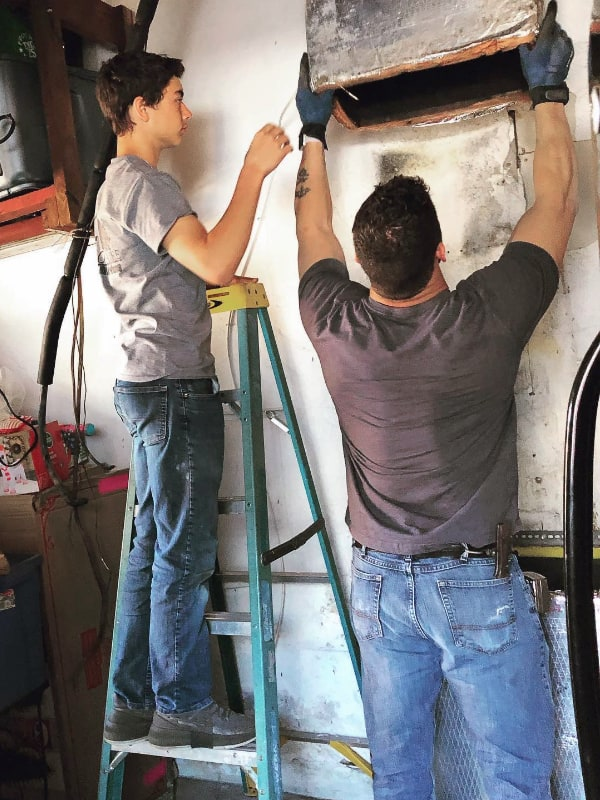 Owner Oaki and son replacing ductwork on old furnace
