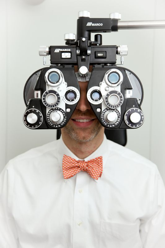 doctor-with-eye-exam-equipment