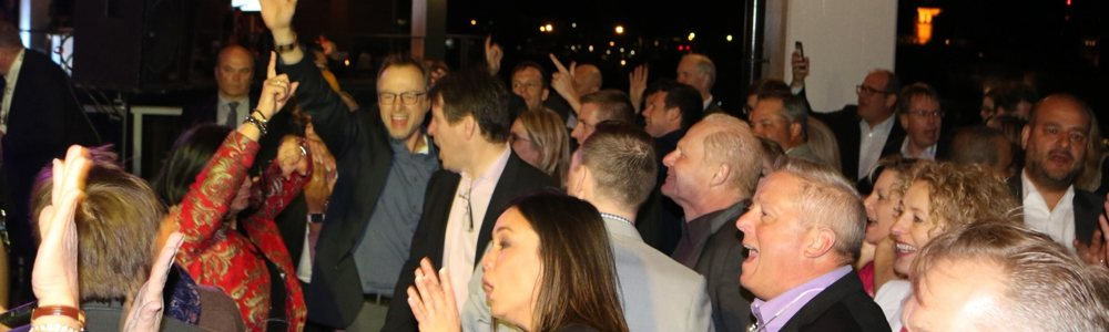 People having a blast from the corporate event entertainment they're experiencing.