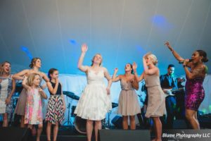 Live Exchange Party Music performing wedding music that got the bride on stage and dancing!