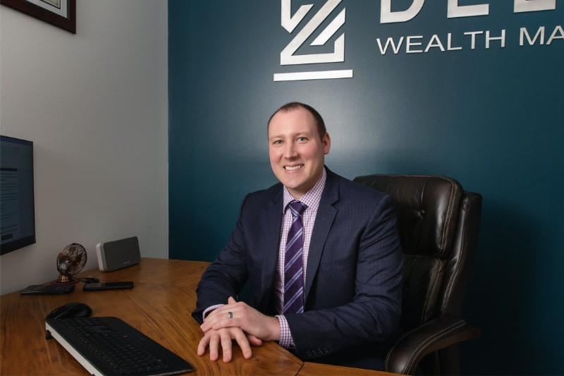 David Deller sitting at his desk, ready to help advise your finances.